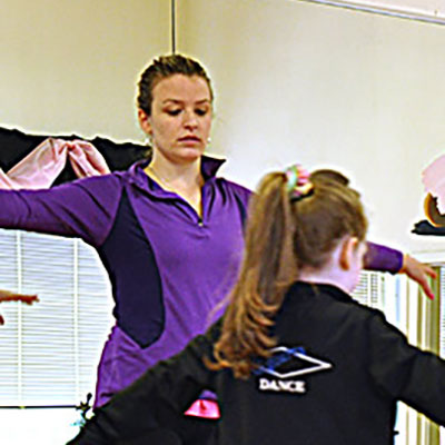 Dance Director Sarah Nugent instructing students during dance class.